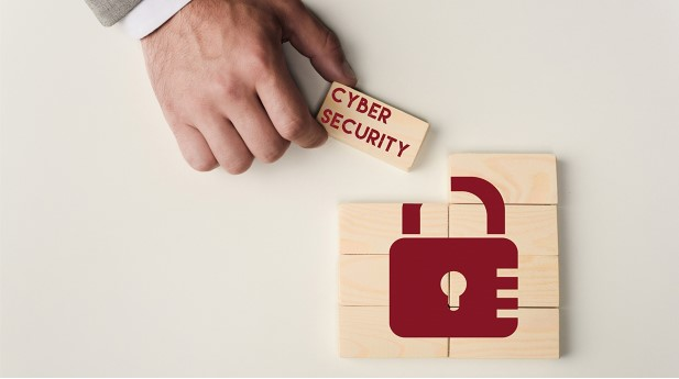 29880175-partial-view-of-man-holding-brick-with-cyber-security