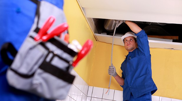 4175162-two-electrician-working-on-ceiling-electrics