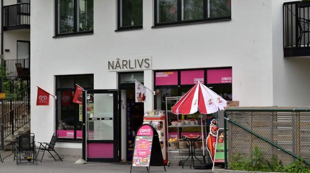 Livsmedelsbutik i en fastighet med bostäder