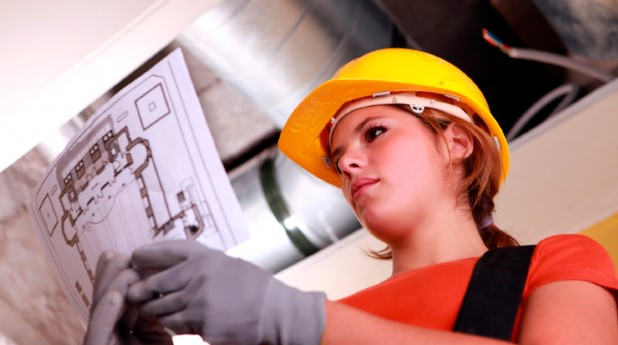2726017-young-female-laborer-reading-plan
