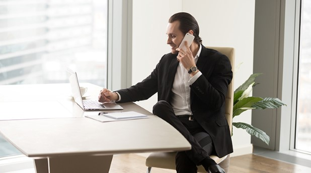 21259531-head-of-company-in-touch-with-partners-by-phone