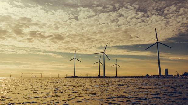 22737603-wind-turbines-power-generator-farm-along-coast-sea