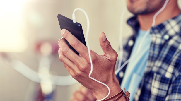 31215514-man-with-earphones-and-smartphone-listening-music
