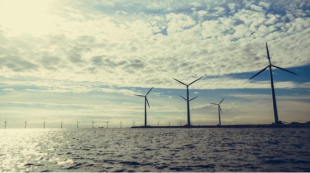 24489540-wind-turbines-power-generator-farm-along-coast-sea