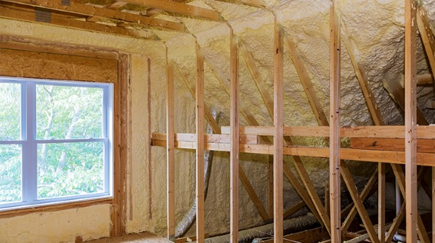 33094859-wall-of-an-apartment-attic-covered-with-insulation-foam