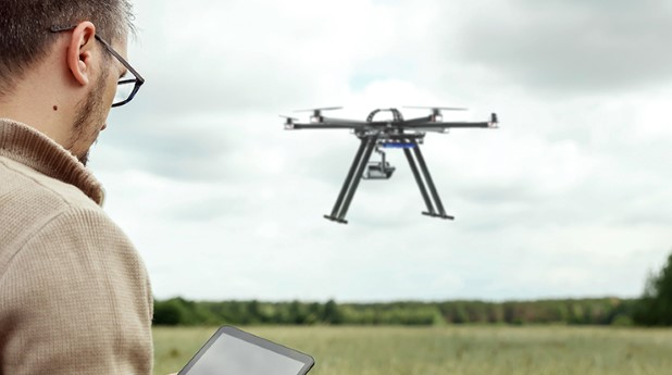 45164052-a-male-farmer-manages-a-drone-over-agricultural-land