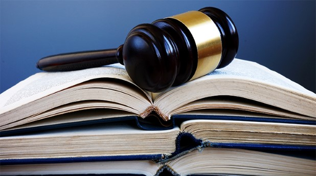31866441-law-books-and-gavel-in-a-court-lawsuit-and-justice