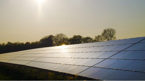 10377851-solar-panels-on-sunset