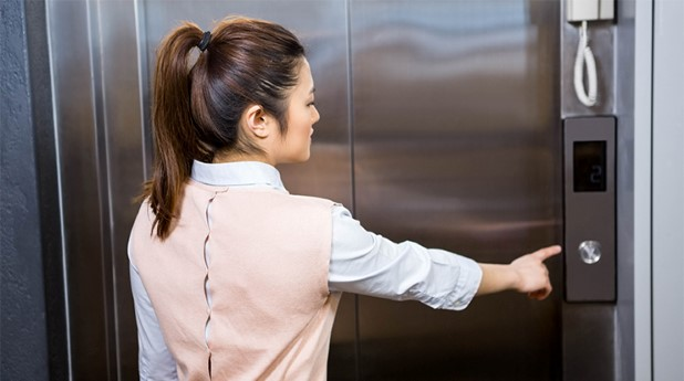 14907672-businesswoman-pressing-elevator-button