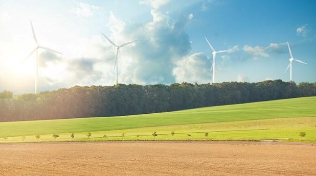42596837-wind-turbine-farm-power-generator-in-beautiful-nature