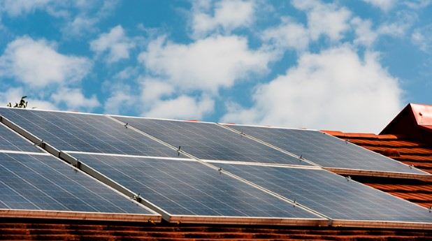 5757379-cells-of-solar-energy-panels-on-the-roof-of-a-building