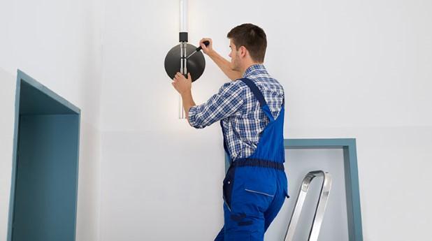13155889-electrician-repairing-light